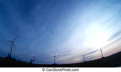 Windturbine Wind Power with a blue sky and sunrise