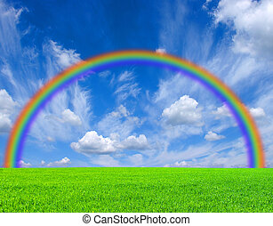 rainbow - a field,  blue sky and rainbow