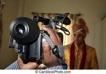 Wedding Videography - A view of a video camera shooting a...