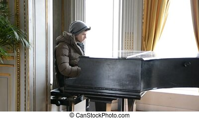Young handsome male artist playing classical piano - Young...