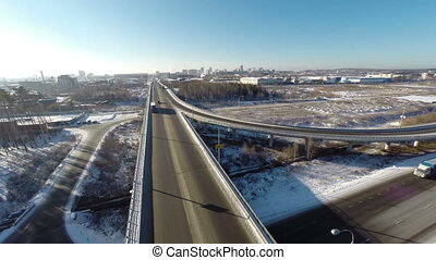 Aerial view road junction at winter cars are driving
