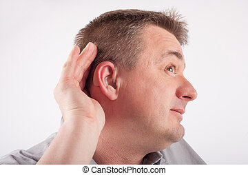 What did you say - Deaf middle-aged man wearing hearing aid...