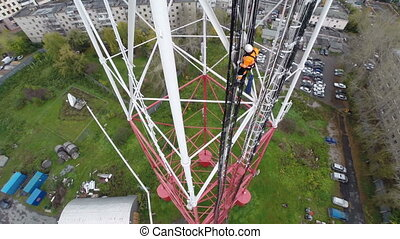 Aerial view workers climb the TV tower - workers climb the...