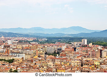Picturesque city of Girona surrounded by mountains