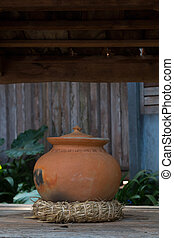 old pottery pot - Old pottery pot in front of Thai home...