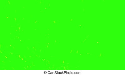 Sparks from the fire on a green screen