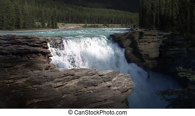 Big WaterFall In The Rockies - Large river feeds into rocky...