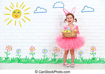 concept easter. Happy girl in costume bunny rabbit with...