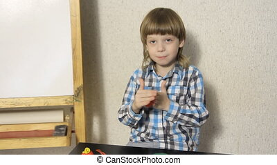 boy sculpts from plasticine - Blond boy sculpts from...