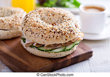 Everything bagels with cream cheese and cucumber -...