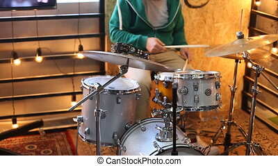 rock drummer playing the drums at the festival stage,video...