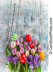 Colorful tulips on wooden table.