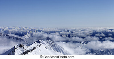 Panoramic view on high mountains in haze Caucasus Mountains,...