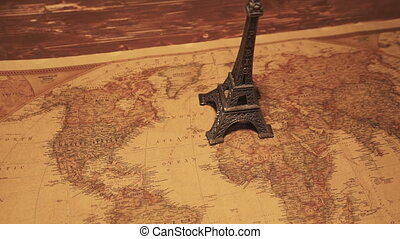 Eiffel tower on a map of Paris. Travel
