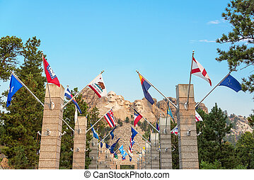 State Flags and Mount Rushmore - Row of state flags leading...