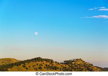 Moon Rising over Hills - Moon rising over hills in Custer...