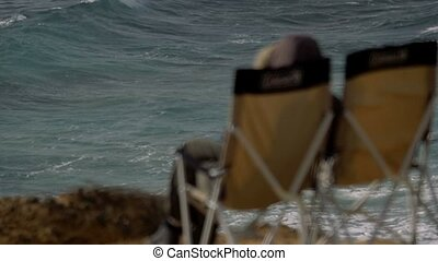 200 FPS Real Slowmo, Water Splashing with two deck chairs in...