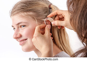 Teen girl and her hearing aid