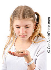 Hearing aid - Young girl holding a hearing aid