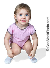Small child sat - Little girl with blue eyes crouched down...