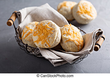 Homemade buttermilk biscuits with cheddar cheese on top