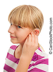Wearing a hearing aid - Teen girl wearing a hearing aid....