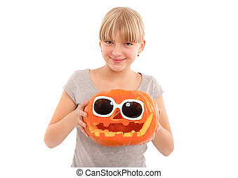 Unusual halloween pumpkin head - Nice young female holding a...