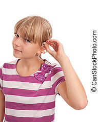Hearing aid putting on - Young female putting on a hearing...