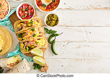 Variety of mexican cuisine dishes on a table - Variety of...