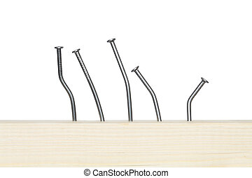 Bent Nails - Few bent nails driven-in wooden board. Isolated...