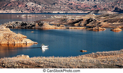 Motorboat Cruising Lake Mead - A white motorboat cruising...