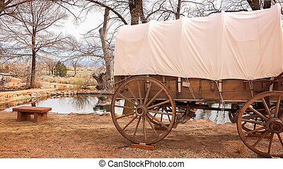 Covered Wagon Sits Next to Natural Spring Water - Covered...