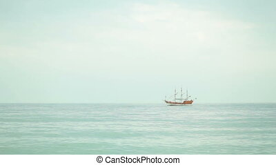 sailboat in the sea at the horizon