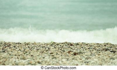 sea surf on pebble beach