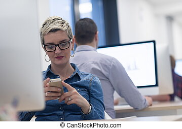 startup business, woman working on desktop computer -...