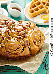 Sticky pecan buns on breakfast table - Sticky pecan buns on...