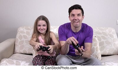 Father and child playing a video game - Happy family, father...