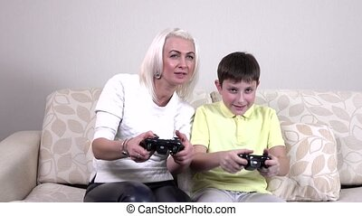 Mother and child playing a video game - Happy family, mother...