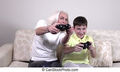 Mother and child playing a video game