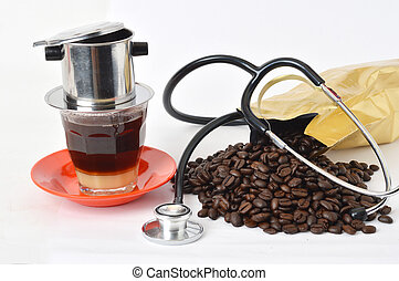 stethoscope with coffee beans on white background