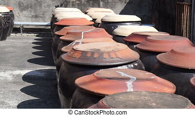 soy sauce fermented in the clay pot - soy bean fermented in...
