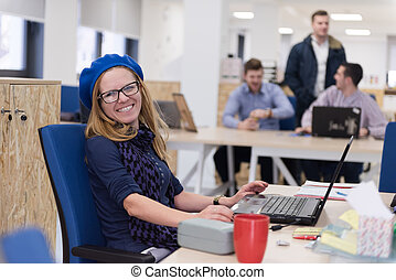 startup business, woman working on laptop computer at modern...