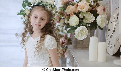 little cute girl poses for the camera