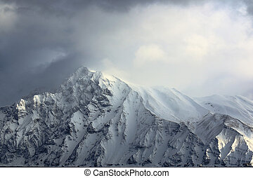 Snowstorm in the mountains in winte - mountain peaks covered...