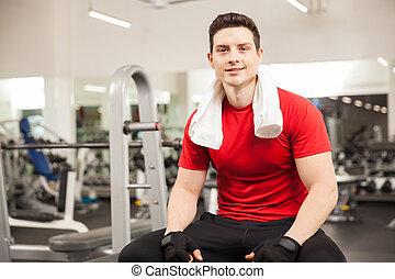Hispanic man taking a break at the gym