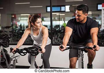 Man talking to a woman at the gym