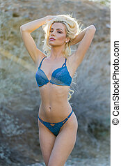 Blonde Sunset Model - A blonde model posing in the desert of...