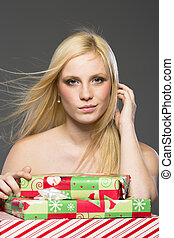 Blonde Holiday Shopper - A blonde model holding holiday...