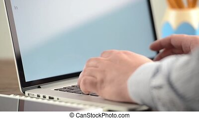 Businessman hands are typing on laptop keyboard -...