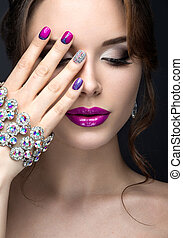 Beautiful girl with a bright evening make-up and purple...